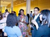 students chat with alumni at a GSICE event